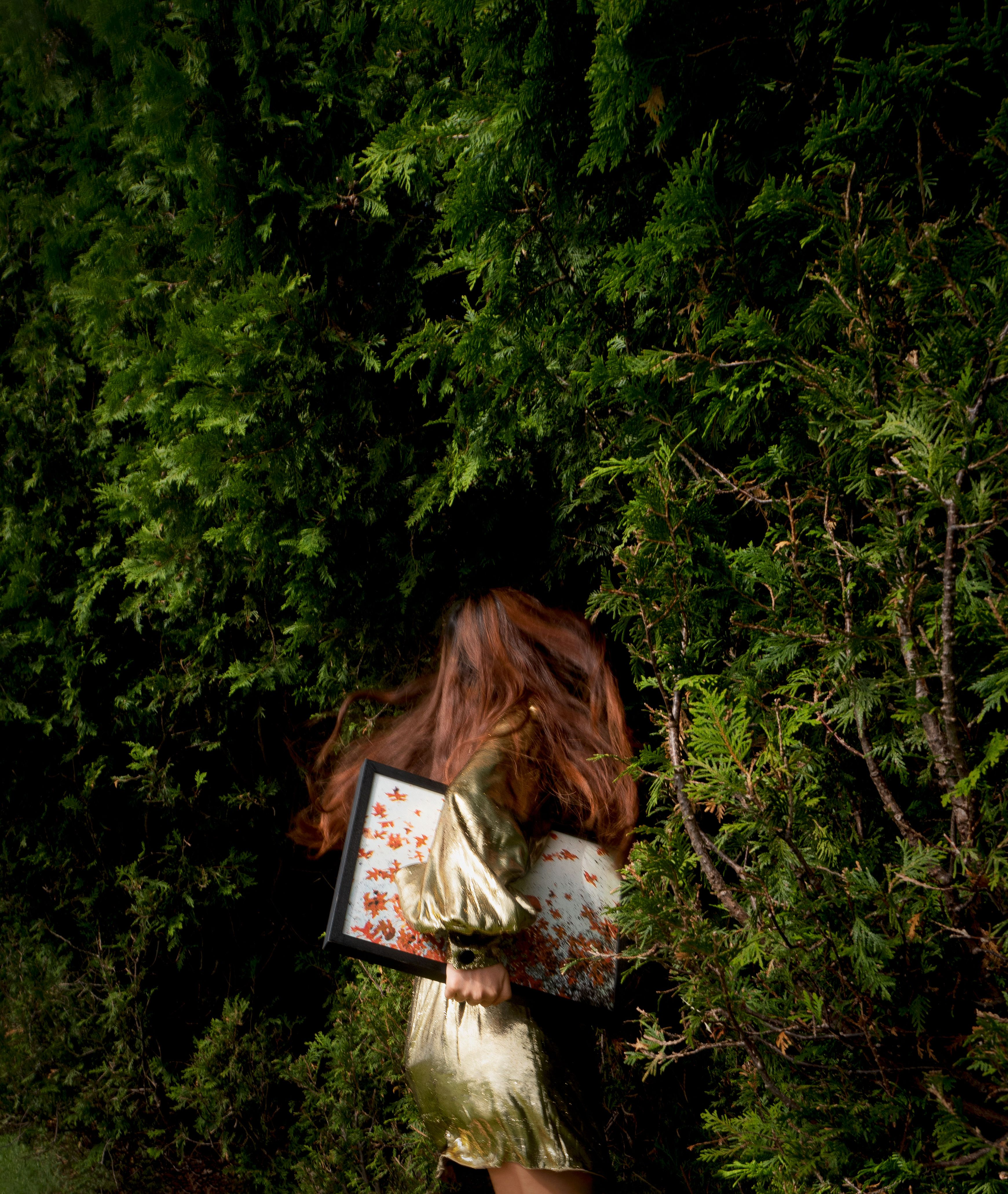 woman in bushes
