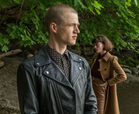 man in leather jacket and woman